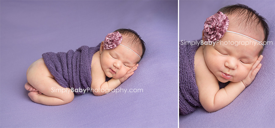 Newborn baby girl photographed on lavender