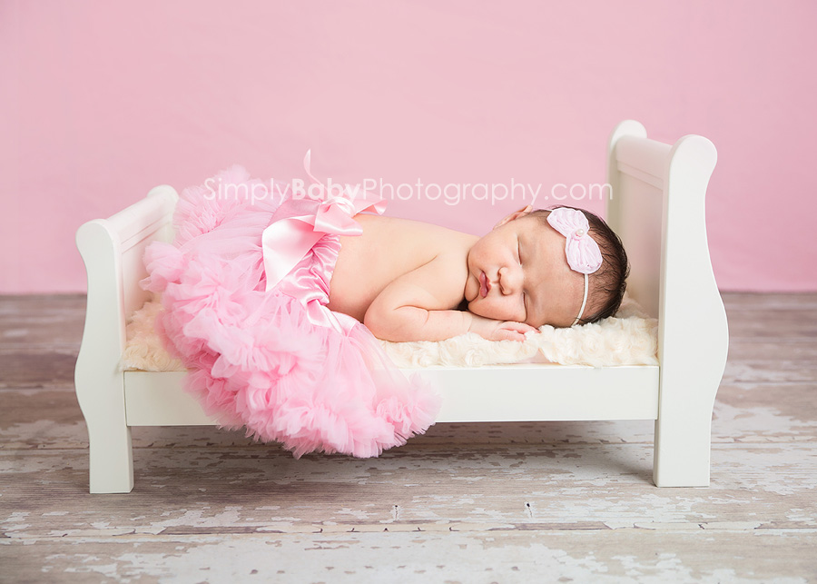 Studio newborn portraiture with props on Oahu
